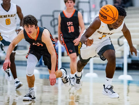 Autauga Academy's Raymond Cutler (1) grabs a steal from Clark Prep's Bubba Ballard (14) during AISA championship action at the Cramton Bowl Multiplex in Montgomery, Ala., on Tuesday February 11, 2020.