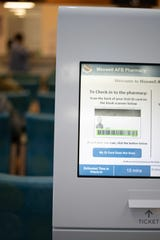 One of the two QFlow kiosks located at the Maxwell Pharmacy, Maxwell Air Force Base, Alabama. The QFlow kiosks displays the estimated wait time and allows patients to choose how they want to be notified that their prescription are ready, which gives patients more choices on how they spend their time.