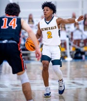 Autauga Academy's Teddy Harris (2) directs from the court against Clarke Prep during AISA championship action at the Cramton Bowl Multiplex in Montgomery, Ala., on Tuesday February 11, 2020.