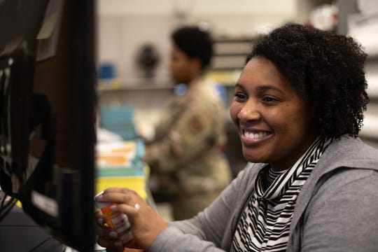 Gabrielle Ervin, Maxwell Pharmacist, looks over a patient's information while sorting prescriptions at the Maxwell Pharmacy, Dec. 19, 2019, Maxwell Air Force Base, Alabama. The Maxwell Pharmacy is responsible for serving the 42nd Air Base Wing, Air University and all of the other tenant units on base, as well as communities across the state of Alabama.