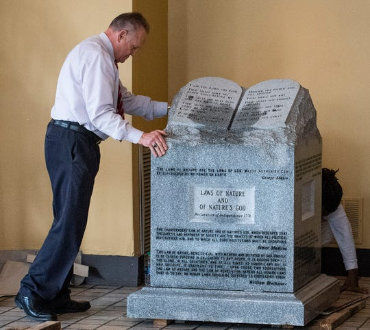 Roy Moore, left, had his Ten Commandments monument installed in the offices of the Foundation For Moral Law in Montgomery, Ala., on Tuesday February 11, 2020.