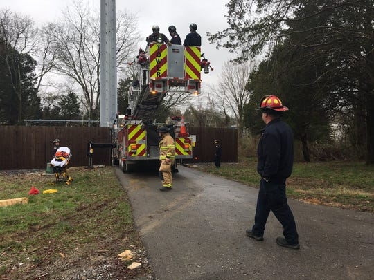 Multiple agencies work to rescue a worker stranded on a cell phone tower in La Vergne on Tuesday morning.
