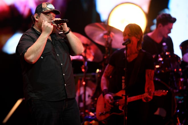 Luke Combs performs during the All the Hall benefit concert at Bridgestone Arena in Nashville, Tenn., Monday, Feb. 10, 2020.