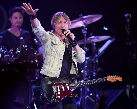 Keith Urban performs during the All the Hall benefit concert at Bridgestone Arena in Nashville, Tenn., Monday, Feb. 10, 2020.