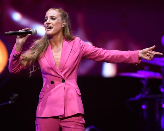 Ingrid Andress performs during the All the Hall benefit concert at Bridgestone Arena in Nashville, Tenn., Monday, Feb. 10, 2020.