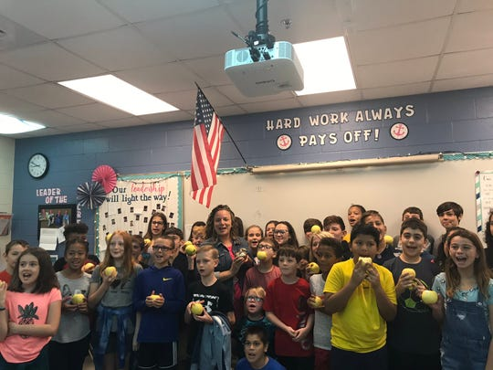Veterans Memorial Elementary fifth grade language arts and social studies teacher Theresa Golden was awarded a Champions for Learning Golden Apple award Tuesday, Feb. 11, 2020.