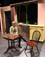 "Edie L. Norlin, Lecturer in Education & Theater at OSU-Newark, in progress set for the school's April production of ""Five Mile Lake"" by Rachel Bonds, a play about two mid-twenties brothers who reunite after one has left home for the big city. Norlin run's the school's Black Box Theater."
