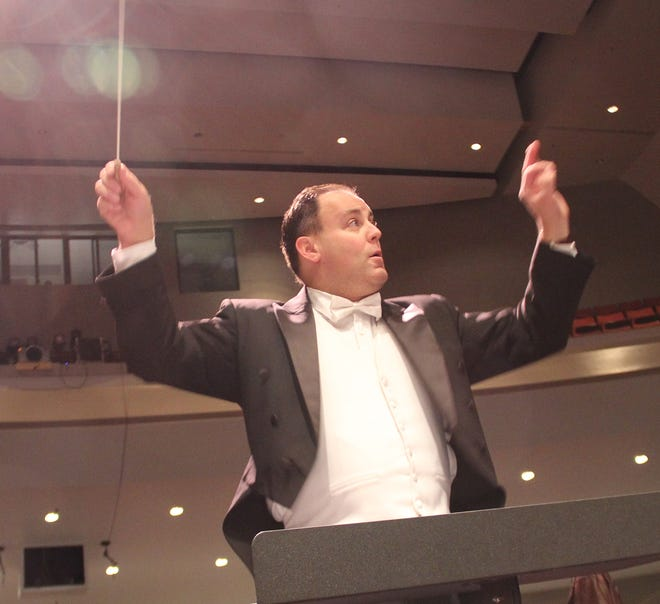 Teun Fetz leads the San Juan College Symphonic Band in a Feb. 14 performance on the college campus in Farmington.