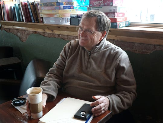 Retiring South Lyon Downtown Development Authority Director Bob Donohue in his office-away-from-the-office hangout: the Corner Caffe on Lafayette.