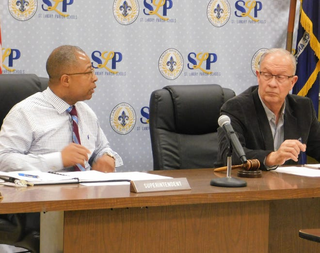 St. Landry Parish School Superintendent Patrick Jenkins discusses crowding concerns at Opelousas Middle School with school board president Donnie Perron (right).
