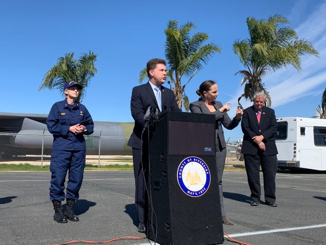 Riverside County Public Health Officer Cameron Kaiser addresses questions from the media at March Air Reserve Base in Riverside County, Calif., during a news conference Tuesday. All of the 195 U.S. citizens quarantined on base since Jan. 29  have tested negative for the deadly coronavirus. The group arrived at the base on a charted flight from Wuhan, China, the epicienter of the outbreak.