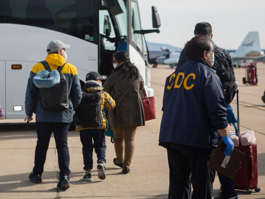 Evacuees from China arrive at Marine Corps Air Station in Miramar on Wednesday, Feb. 5, 2020, in this photo provided by the U.S. government.
