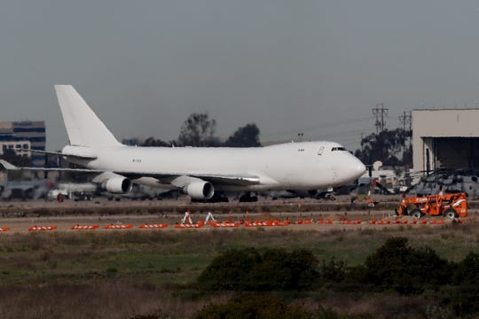 A plane carrying evacuees from the virus zone in China lands at Marine Corps Air Station Miramar in San Diego on  Feb. 5, 2020.