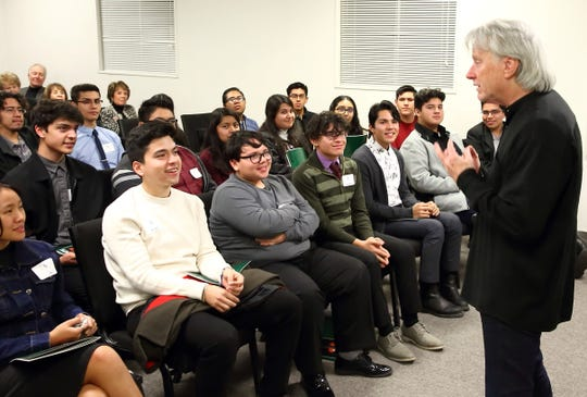 Carl St. Clair, music director of the Pacific Symphony, speaks to members of the Cathedral City High School band at a post-concert meet and greet at McCallum Theatre.
