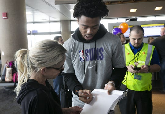 Suns guard Jalen Lecque signs an autograph at Terminal 4 at Sky Harbor International Airport in Phoenix on Feb. 11, 2020. Suns players surprised Southwest Airlines passengers as they made boarding announcements, took boarding passes and even worked on the runway.