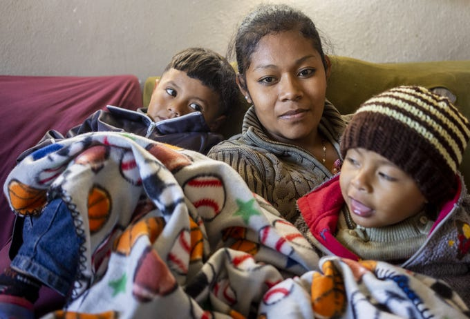 Mar'a del Carmen Melcho, 24, with her two children Erick Altamirano, 2, on right, and Luis Altamirano, 4, rest at the shelter in Nogales, Mexico. The Migrant Protection Protocols expanded to Nogales, Sonora, in early January. One month later, it remains tough to gauge its full impact on this border city as apprehensions continue dropping, but asylum seekers continue arriving.