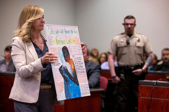 Claudia Brough, mother of Colin Brough, shows a canvas painting memorializing Colin during the sentencing of Steven Jones on Feb. 11, 2020, at Coconino County Superior Courthouse in Flagstaff.