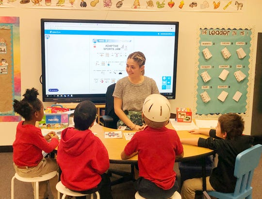 Kelsey Taylor, a special-education teacher, works on a reading comprehension lesson with second-graders at Frye Elementary in Chandler on Tuesday, Feb. 11, 2020.
