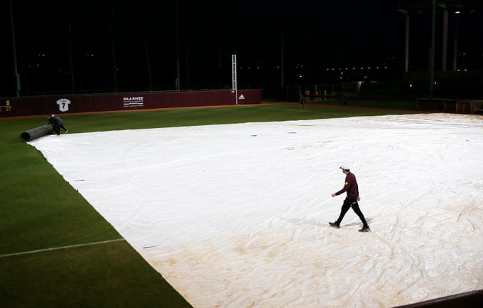 A tarp covers the infield at Farrington Stadium before ASU plays Tennessee in Tempe February 10, 2019.