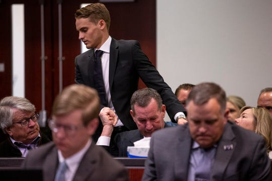 Kyle Zientek, one of the victims in the 2015 NAU shooting, holds Doug Brough's hand as he walks up to speak during the sentencing of Steven Jones on Feb. 11, 2020, at Coconino County Superior Courthouse in Flagstaff. Jones pleaded guilty to manslaughter and aggravated assault in the shooting death of Northern Arizona University student Colin Brough and the injury of Piring and two others.