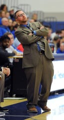 Cedar Crest head coach Tommy Smith uses some body English during the third quarter of play.