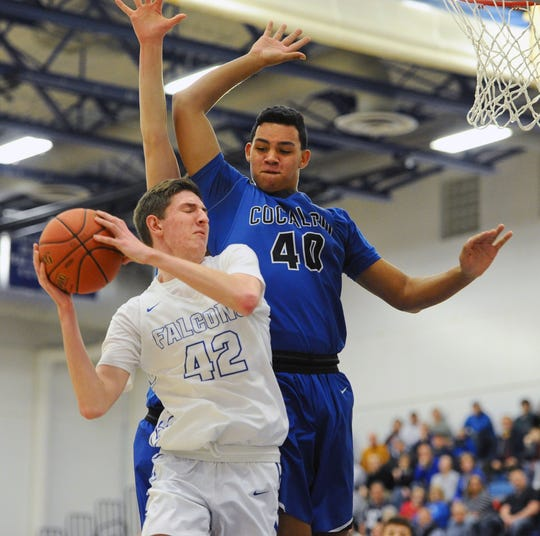 Cedar Crest's Jason Eberhart (42) is fouled by Cocalico's Trey Griffin (40) as he goes to the basket during the third quarter of action.