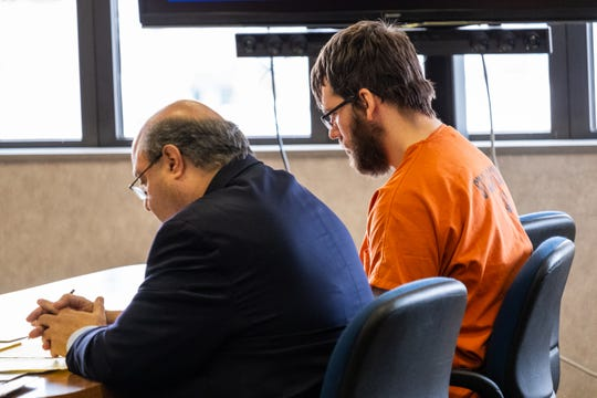 Joshua Bauman, right, sits at the defendant's table next to his attorney Bill Colovos during a competency hearing in front of St. Clair County Circuit Judge Michael West Tuesday, Feb. 11, 2020, in the St. Clair County Courthouse. Bauman is being charged in the fatal shooting on Aug. 24 of Port Huron Police Lt. Joel Wood and wounding two others.