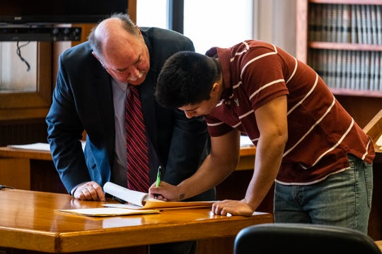 Louis Manuel Ramirez Jr., 19, right, confers with his attorney, Donald Sheldon, during a hearing Tuesday, Feb. 11, 2020, in the St. Clair County Courthouse in Port Huron. Ramirez is facing two felonies after police said he threatened to carry out violence at Marysville High School's junior prom.