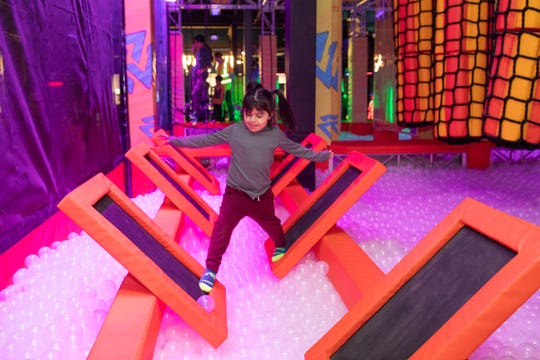 Iliana Rivera makes her way through the Warrior Course on Thursday at the newly opened Urban Air Adventure Park at the Galleria at Crystal Run Mall in the Town of Wallkill.