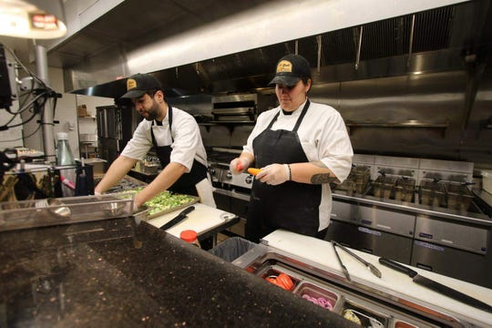 Jeffrey Nieves, left, of Montgomery, and Stacey Garmencia, of Pine Bush, do prep work in the kitchen at 110 Grill at the Galleria at Crystal Run Mall on Feb. 5.