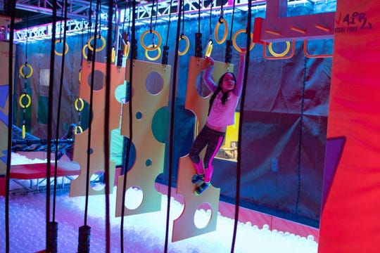 Samantha Jayona makes her way through the Warrior Course at Urban Air Adventure Park at the Galleria at Crystal Run Mall.