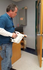 Charlie Caratozzola, assistant supervisor in the buildings and grounds department in Chambersburg Area School District, uses the Protexus electromagnetic sprayer.