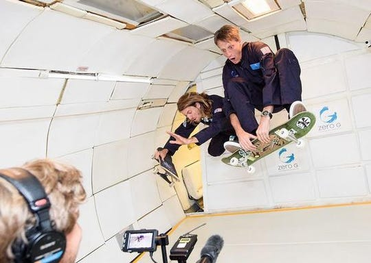 Professional skateboarders Tony Hawk and Aaron Hamoki on a ZERO-G flight.