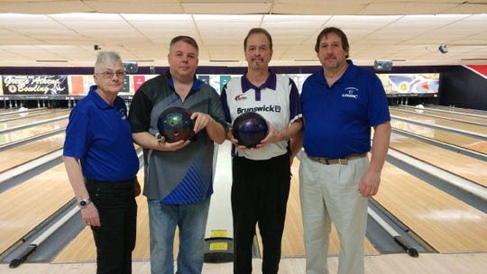 Tommy Kress, 66, middle right, defeated Chris Lamb, 50, to capture the Rochester Bowling Association's 24th annual John Nevada Senior Masters Championships at Dewey Gardens. Kress, coming off two knee replacement surgeries, averaged 265.2 over his last five games. Also pictured are RBA's Mimi Lucy, far left, and tournament director Ken Haslip.