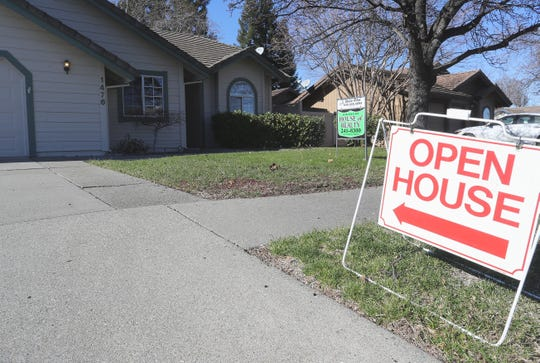 An open house is advertised at a home for sale in the 1400 block of River Ridge Drive.
