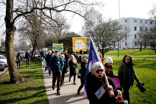 About 1,000 carbon cap-and-trade bill supporters march around the Oregon State Capitol in Salem on Feb. 11, 2020. Senate Bill 1530 would impose an economy-wide cap on carbon emissions and charge the stateÕs largest polluters for emissions over the limit.
