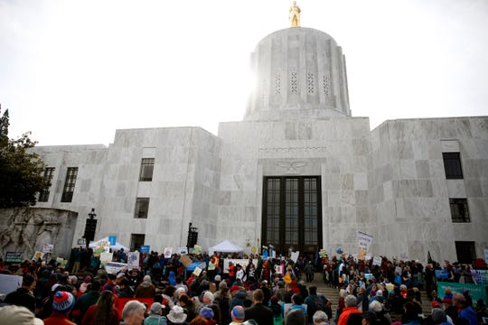 About 1,000 carbon cap-and-trade bill supporters rally at the Oregon State Capitol in Salem on Feb. 11, 2020. Senate Bill 1530 would impose an economy-wide cap on carbon emissions and charge the stateÕs largest polluters for emissions over the limit.