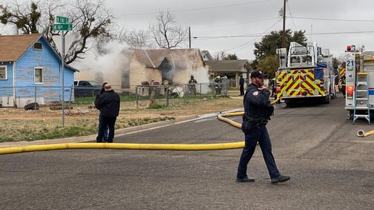 San Angelo firefighters rush to extinguish a blaze in the 1600 block of N. Farr St. Tuesday, Feb. 11, 2020.