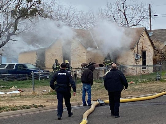 San Angelo firefighters work to extinguish a structure fire in the 1600 block of N. Farr Street on Tuesday, Feb. 11, 2020.