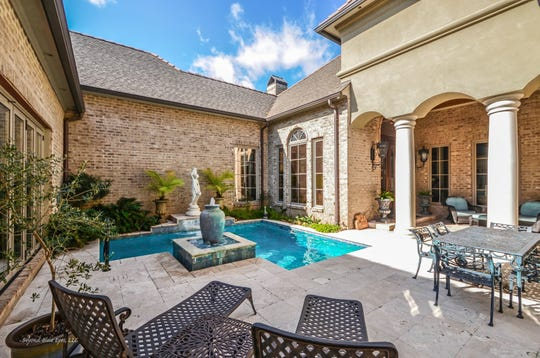 Entertaining is easy with the inground pool and and upscale outdoor space.