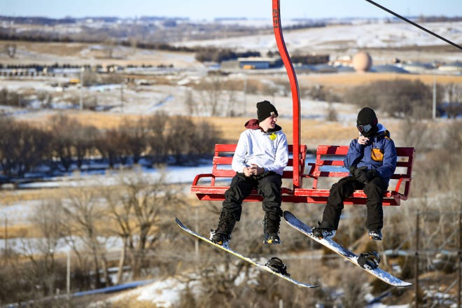 Patrons ride the chair lift to the top of the hill on Tuesday, Feb. 11, at Great Bear Ski Valley in Sioux Falls.