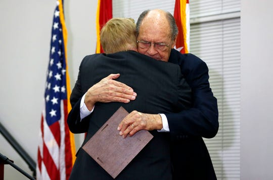 Former Evangel University president Dr. Robert Spence gives a hug to Springfield Mayor Ken McClure after Spence was presented a key to the city during a ceremony and reception at the Busch Municipal Building on Monday, Feb. 10, 2020.