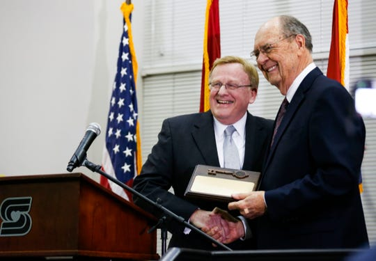 Springfield Mayor Ken McClure presents former Evangel University president Dr. Robert Spence with a key to the city during a ceremony and reception at the Busch Municipal Building on Monday, Feb. 10, 2020.