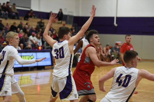 Waynesboro's Luke Young (30) guards Riverheads' Grant Painter during a game earlier this season.