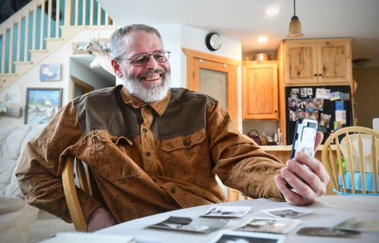 Rick Colbert smiles while talking on the phone with Chuck Owen Saturday, Feb. 8, 2020, at his home near Bemidji. Owen stayed in St. Cloud with Colbert's grandparents 70 years ago.