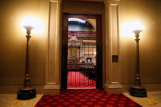 The Minnesota Senate chamber is gated Friday, Feb. 7, 2020, but will open when the 2020 legislative session convenes on Tuesday in St. Paul, Minn. The must-do list includes figuring out a compromise on bonding projects that would close the yawning gap between Democrats' $2 billion-plus wish list and Republicans' preference for something about half that size. (AP Photo/Jim Mone)