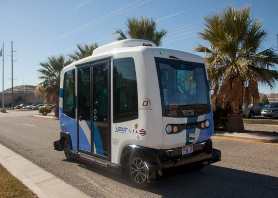 Representatives from UTA and UDOT demonstrate an autonomous vehicle at the annual transportation expo at the Dixie Convention Center Tuesday, Feb. 11, 2020.