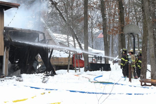 Fire crews fight a fire on Tuesday, Feb. 11, 2020, at 5370 Clarices Circle in Stevens Point, Wis. There were no injuries reported in the fire, but the home was ruled a total loss.