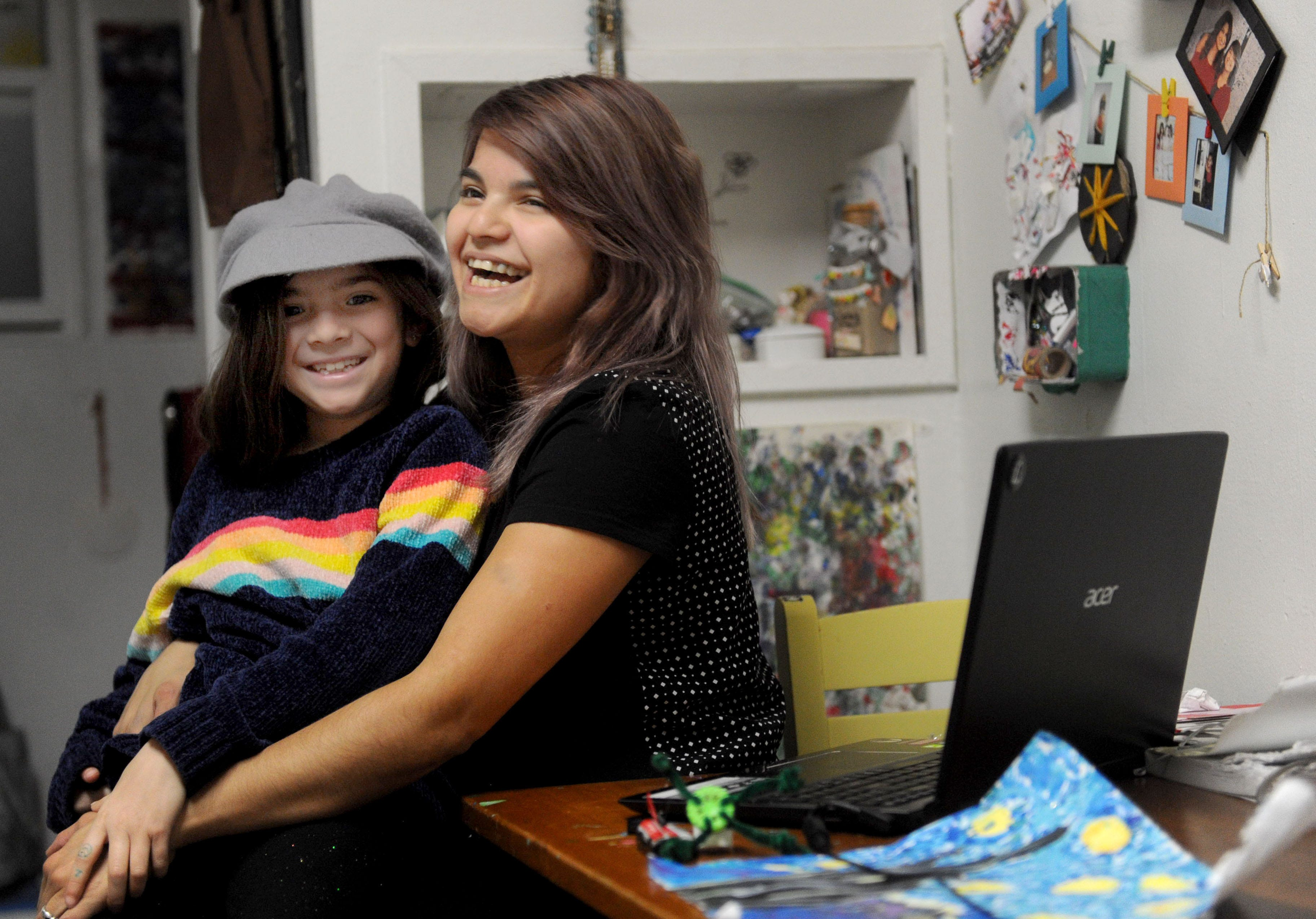 Jessica Quiroz hugs her daughter, Cadence. They have lived at the City Center shelter in Ventura for the past two years.