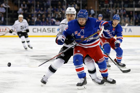 Trevor Moore battles the Rangers defenseman Tony DeAngelo for control of the puck during the Kings' loss in New York on Sunday. Moore, a Thousand Oaks native, was traded to the Kings from the Maple Leafs on Feb. 5.